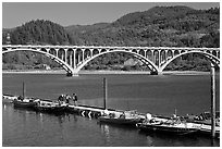 Small boat deck and Rogue River bridge. Oregon, USA ( black and white)