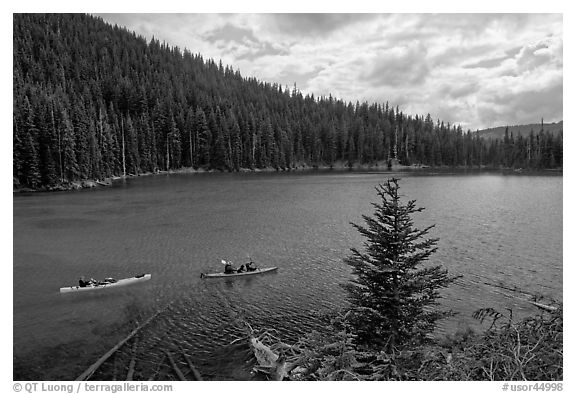 Kayaks on emerald waters, Devils Lake, Deschutes National Forest. Oregon, USA (black and white)