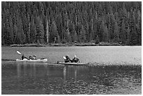 Parents kayaking with children in tow, Devils Lake. Oregon, USA (black and white)