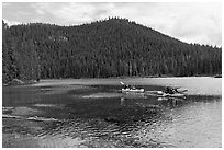 Family kayaking on Devils Lake. Oregon, USA (black and white)