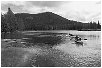 Parents towing children in kayak, Devils Lake. Oregon, USA (black and white)