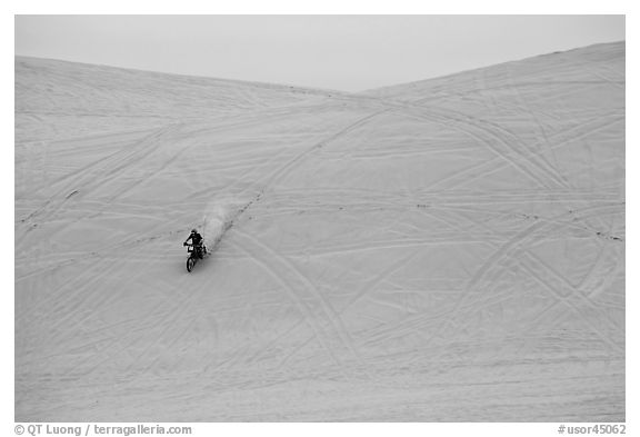 Motorcyle down dune, Oregon Dunes National Recreation Area. Oregon, USA (black and white)