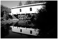 White covered Bridge reflected in river, Willamette Valley. Oregon, USA (black and white)