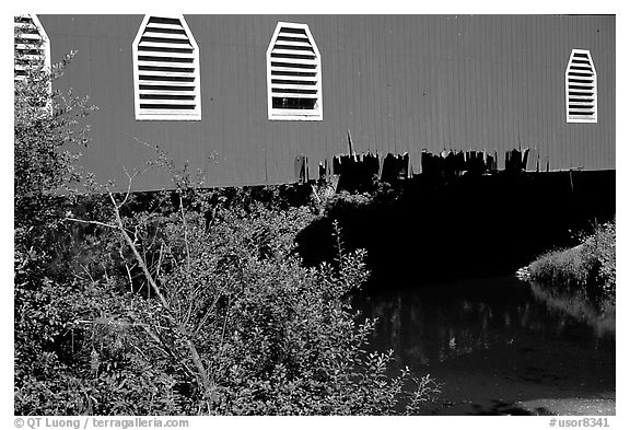 Detail of red covered bridge and river, Willamette Valley. Oregon, USA (black and white)