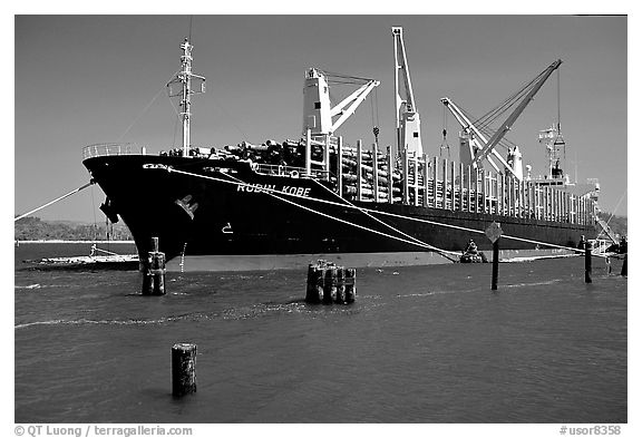 Cargo ship loading floated timber. Oregon, USA (black and white)
