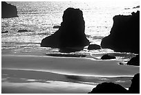 Rocks, water reflections, and beach, late afternoon. Bandon, Oregon, USA (black and white)