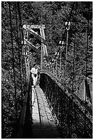 Woman hiking on suspension bridge, Lava Canyon. Mount St Helens National Volcanic Monument, Washington (black and white)