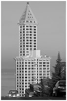Smith Tower and cars on steep street, early morning. Seattle, Washington ( black and white)