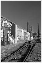 Railroad, mural, and high-rise towers. Seattle, Washington (black and white)