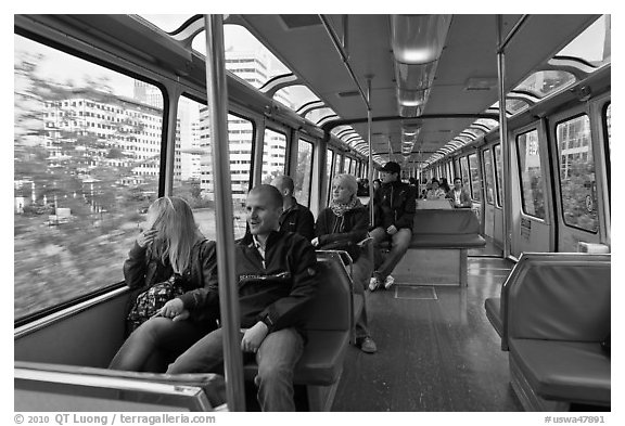 Riders in monorail. Seattle, Washington