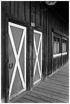 Painted doors and wood building, Winthrop. Washington (black and white)