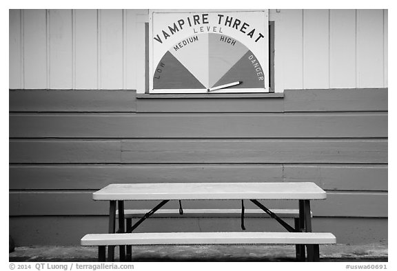 Bench and vampire threat sign near Forks. Olympic Peninsula, Washington (black and white)