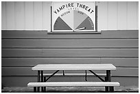 Bench and vampire threat sign near Forks. Olympic Peninsula, Washington ( black and white)