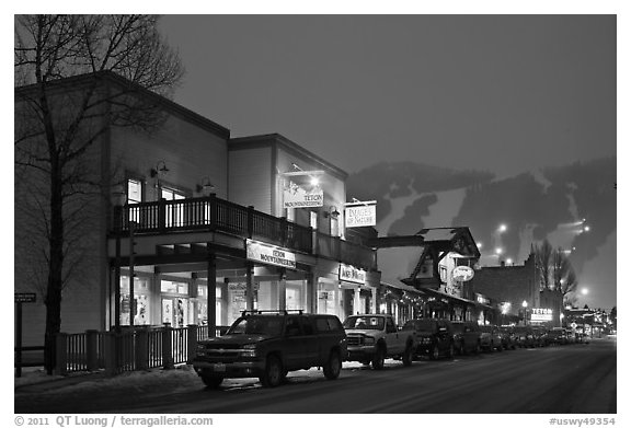Storehouses and night-lit Snow King ski area. Jackson, Wyoming, USA (black and white)