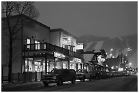 Storehouses and night-lit Snow King ski area. Jackson, Wyoming, USA ( black and white)