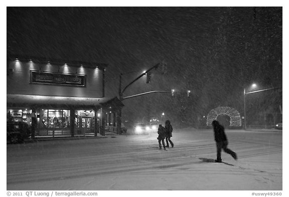 People cross street in night blizzard. Jackson, Wyoming, USA (black and white)