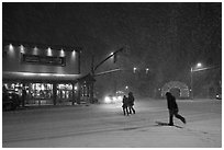 People cross street in night blizzard. Jackson, Wyoming, USA ( black and white)