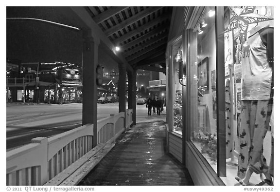 Storefront and gallery by night. Jackson, Wyoming, USA (black and white)