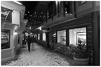 Alley with art galleries, winter night. Jackson, Wyoming, USA ( black and white)