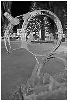 Town square statue framed by ice sculpture. Jackson, Wyoming, USA (black and white)