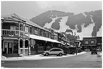 Town square stores and ski slopes in winter. Jackson, Wyoming, USA ( black and white)