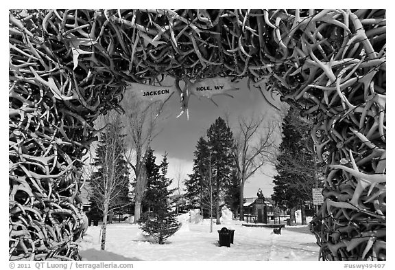 Town Square framed by Antler Arch in winter. Jackson, Wyoming, USA (black and white)
