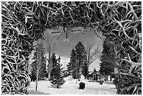 Town Square framed by Antler Arch in winter. Jackson, Wyoming, USA ( black and white)