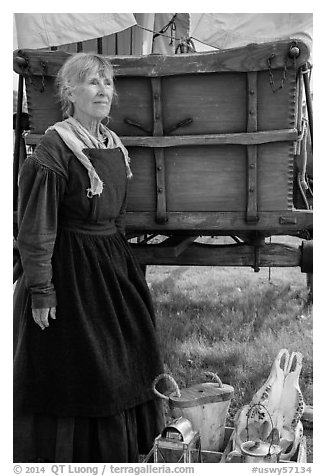 Woman with Pionneer wagon. Fort Laramie National Historical Site, Wyoming, USA (black and white)