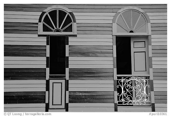 Red window shutters and striped walls, Parc De Bombas, Ponce. Puerto Rico