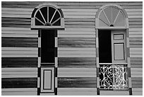 Red window shutters and striped walls, Parc De Bombas, Ponce. Puerto Rico ( black and white)
