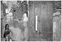 Woman in front of a decaying brick wall, Ponce. Puerto Rico (black and white)