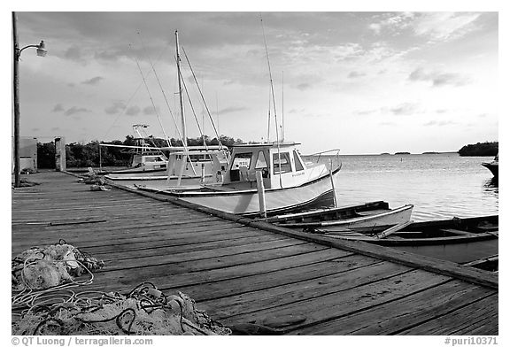Pier and small boats at sunset, La Parguera. Puerto Rico (black and white)