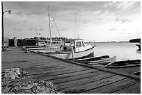 Pier and small boats at sunset, La Parguera. Puerto Rico ( black and white)