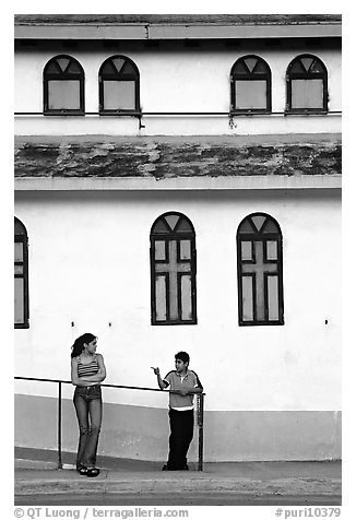 Woman and boy talking besides a church, La Parguera. Puerto Rico (black and white)