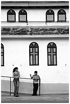 Woman and boy talking besides a church, La Parguera. Puerto Rico ( black and white)