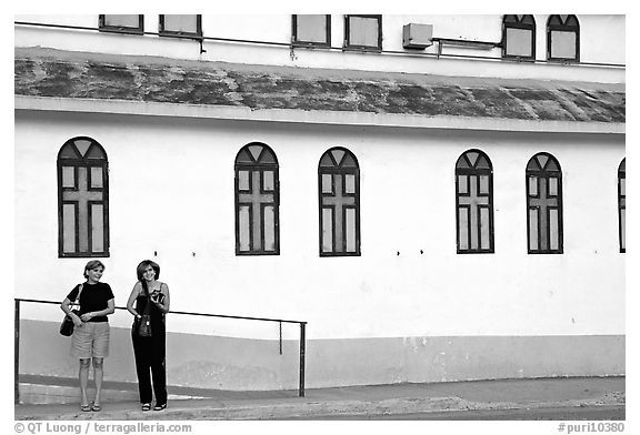 Two women standing in front of a church, La Parguera. Puerto Rico (black and white)