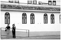 Two women standing in front of a church, La Parguera. Puerto Rico ( black and white)