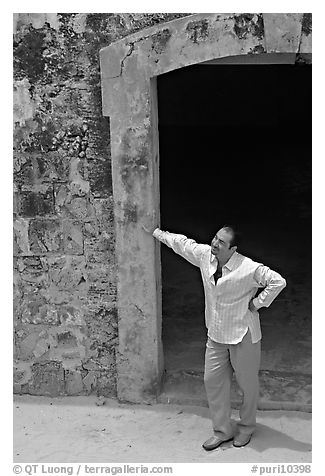Man standing next to a doorway, El Morro Fortress. San Juan, Puerto Rico (black and white)