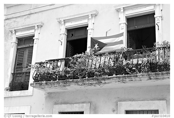 Balcony and flag of Puerto Rico. San Juan, Puerto Rico (black and white)