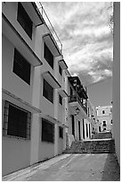 Passage with modern painted houses. San Juan, Puerto Rico (black and white)
