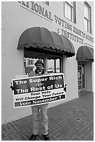 African-American man holding a voting sign in front of the voting rights museum. Selma, Alabama, USA (black and white)