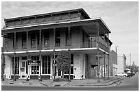 Historic brick building with balcony. Selma, Alabama, USA (black and white)