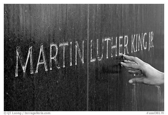 Hand touching the letters Martin Luther King on the Civil Rights Memorial wall. Montgomery, Alabama, USA (black and white)