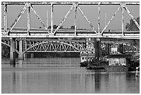 Bridges over Arkansas River, submarine and riverboats at sunrise. Little Rock, Arkansas, USA (black and white)