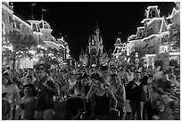 Main Street at night with crowds and castle. Orlando, Florida, USA (black and white)