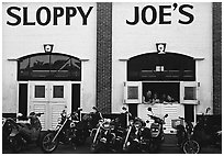 Motorbikes in front of Sloppy Joe. Key West, Florida, USA (black and white)