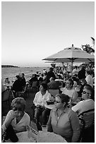 Crowds celebrating sunset at Mallory Square. Key West, Florida, USA ( black and white)