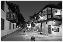 Old street and historic buildings with flags by night. St Augustine, Florida, USA ( black and white)