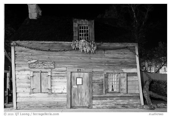 Facade of oldest wooden school house in the US by night. St Augustine, Florida, USA (black and white)
