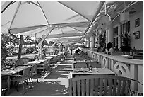 Outdoor restaurant tables, South beach, Miami Beach. Florida, USA ( black and white)